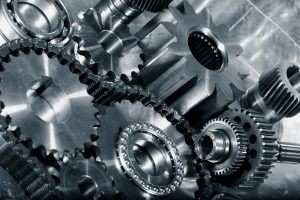 cogwheels and gears in titanium, aerospace engineering parts in